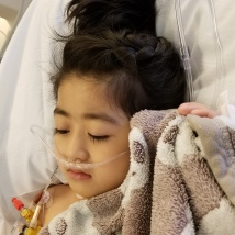 2nd day of recovery. Mommy washed her up and did her hair. 3 lines removed from her body. Everyday more will be removed.