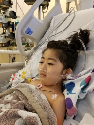 Day 2 post op... finally tied her hair.