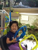 Getting some fresh air in kiddie car at the hospital