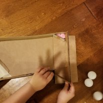 Making an adjustment at the end of the ramp to to make the ping pong balls or marbles roll out easily.