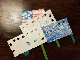 Ellis made the first 3 flags for us to wave. Elliot was dissatisfied with his sister's flag, so he made his own U.S.A. flag.
