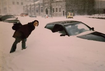 In the early 2000s, walking to school and saw this car half filled with snow