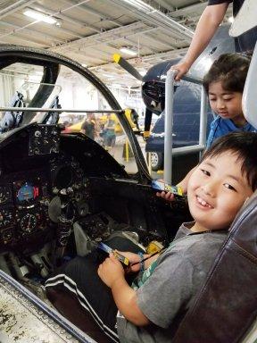 Sitting inside the fighter jet plane.