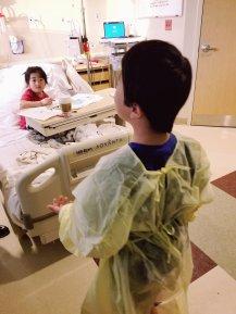 Elliot visiting us in scrubs.
